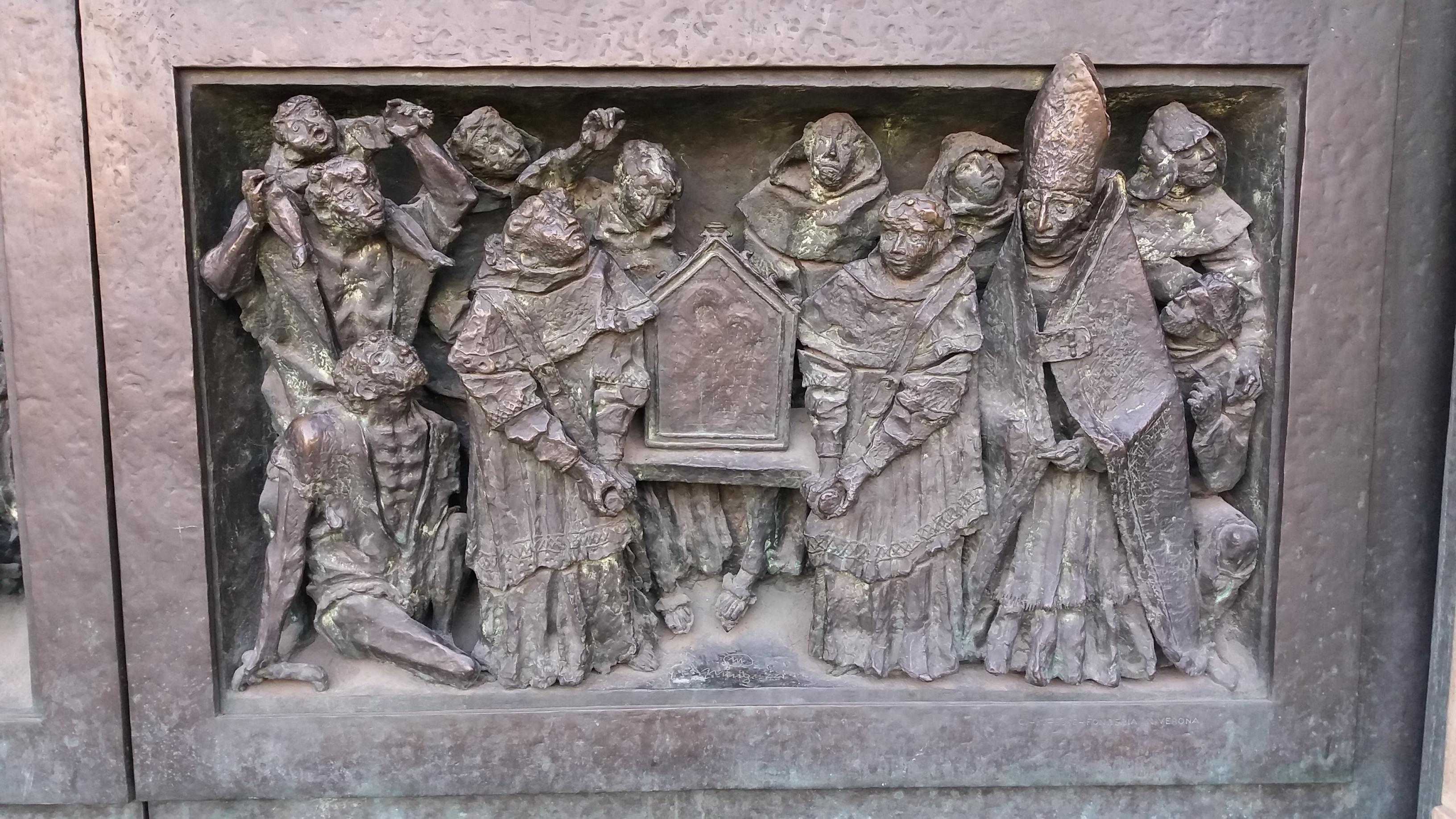 Formella all'interno della quinta porta de Duomo di Milano, realizzata da Luciano Minguzzi, nel 1965.